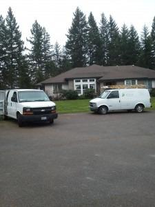 mold removal company vans at client house
